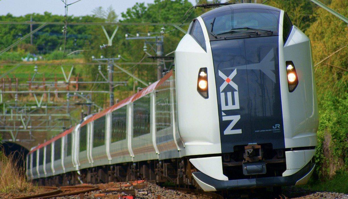 the_narita_express_train_running_a_natural_woodland